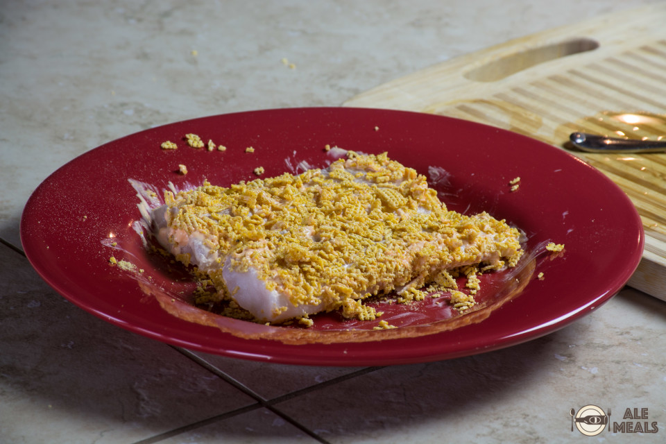 Cod fillets dredged in crumbled corn Chex