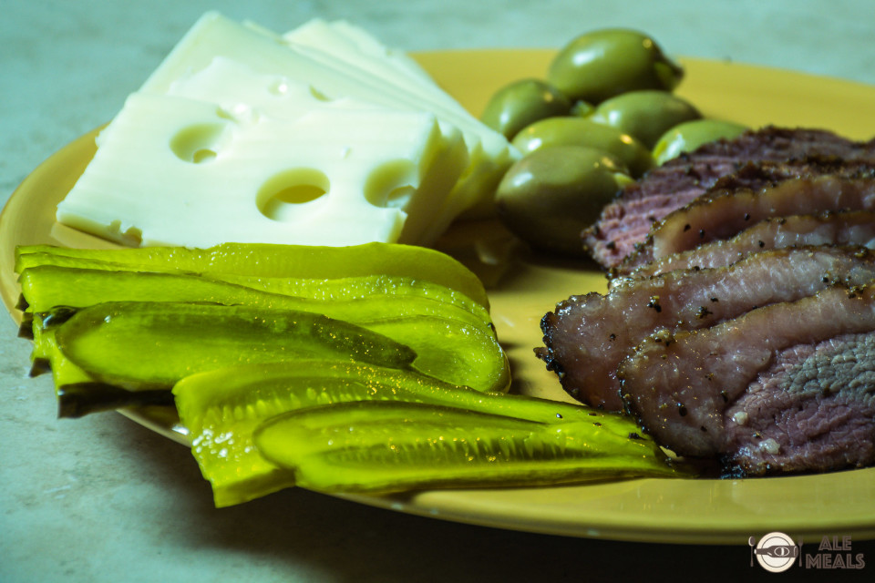 Hop Manna Pastrami served with swiss cheese and pickles