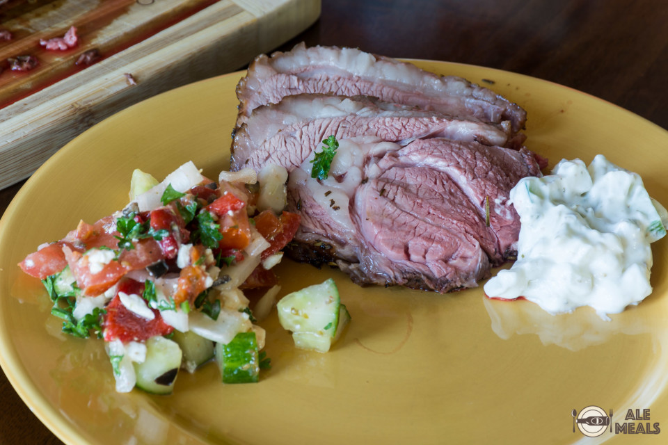 Belgian Ale Smoked Leg of Lamb served with Mediterranean salad and tzatziki sauce
