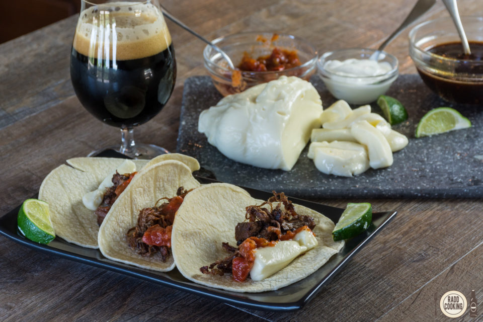 Tacos de Lengua with stout adobo sauce and queso fresco